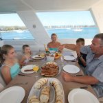 Family dinner on a budget friendly houseboat holiday